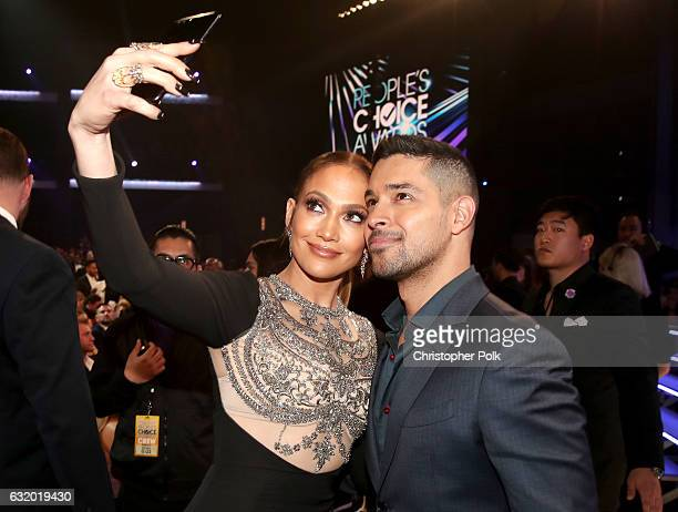 Entertainer Jennifer Lopez and actor Wilmer Valderama attend the People's Choice Awards 2017 at Microsoft Theater on January 18 2017 in Los Angeles...