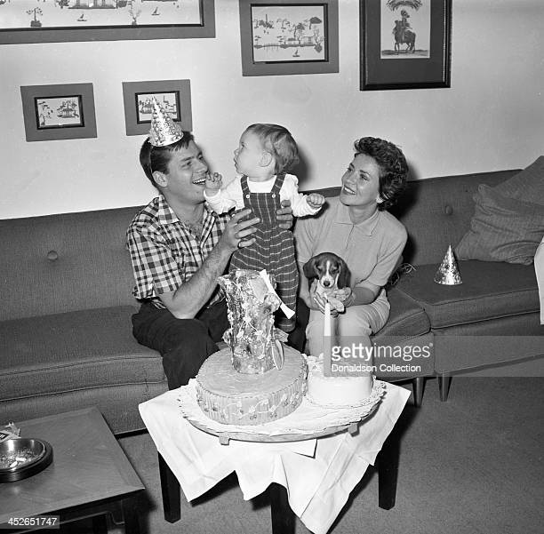 Entertainer Jerry Lewis backstage at the RKO Palace Theater with his wife Patti Palmer and son Scott Anthony Lewis having a party with cake and their...