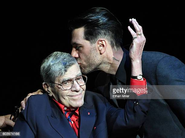 Entertainer Jerry Lewis is kissed by illusionist Criss Angel during Criss Angel's HELP charity event at the Luxor Hotel and Casino benefiting...