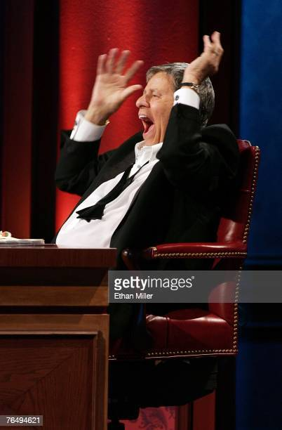 Entertainer Jerry Lewis laughs while watching a performer during the 42nd annual Labor Day Telethon to benefit the Muscular Dystrophy Association at...