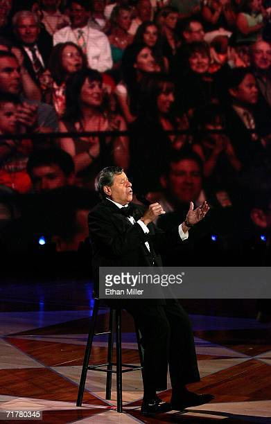 Entertainer Jerry Lewis sings in front of a video image of the audience during the 41st annual Labor Day Telethon to benefit the Muscular Dystrophy...