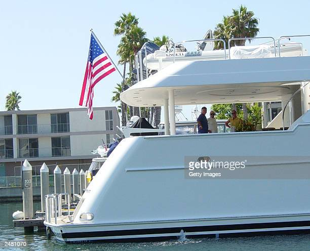 Entertainer Johnny Carson stands on his yacht the Serengeti with his wife Alexis and an unidentified person August 29 2003 in Marina del Ray...