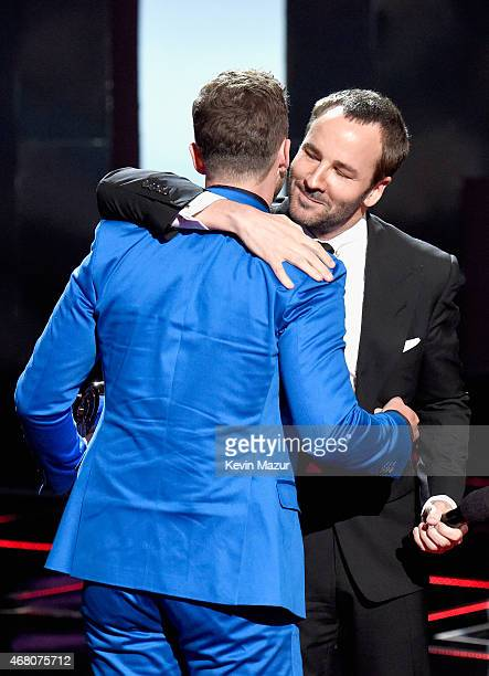 Entertainer Justin Timberlake accepts the iHeartRadio Innovator Award from designer Tom Ford onstage during the 2015 iHeartRadio Music Awards which...