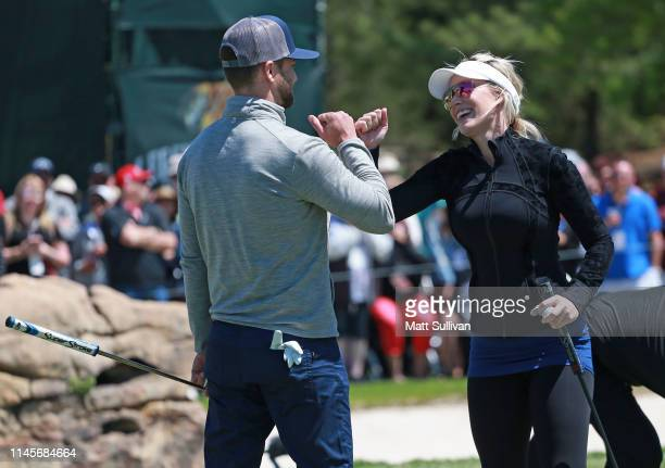 Entertainer Justin Timberlake bumps fists with Paige Spiranac on the ninth hole during the final round of the PGA TOUR Champions Bass Pro Shops...