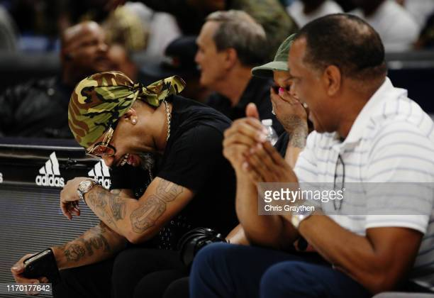 Entertainer Juvenile and Pelicans head coach Alvin Gentry look on during the BIG3 Playoffs at Smoothie King Center on August 25, 2019 in New Orleans,...
