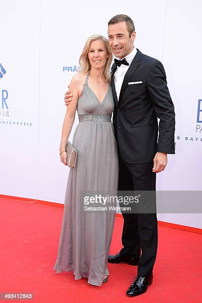Entertainer Kai Pflaume and his wife Ilke arrive at the Prinzregententheater on May 23 2014 in Munich Germany