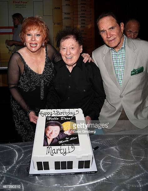 Entertainer Karon Kate Blackwell her husband actor/comedian Marty Allen and impressionist Rich Little hold up a cake to celebrate Allen's 93rd...