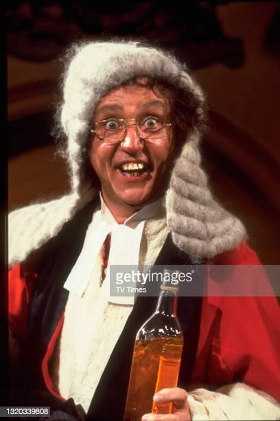 Entertainer Ken Dodd dressed as a drunken judge, circa 1978.