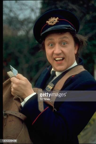 Entertainer Ken Dodd dressed as a postman, circa 1969.
