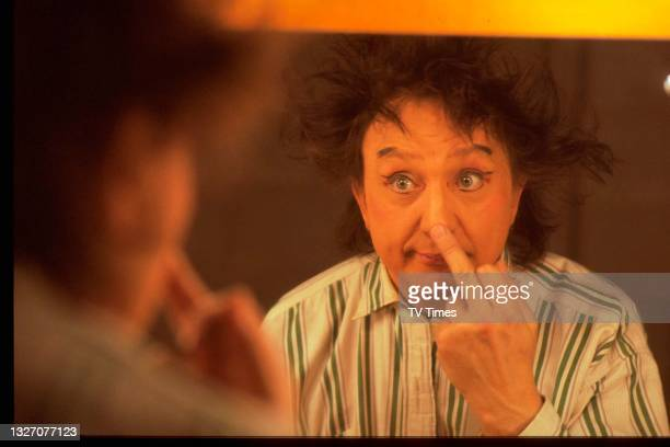 Entertainer Ken Dodd looking in a dressing room mirror, circa 1978.