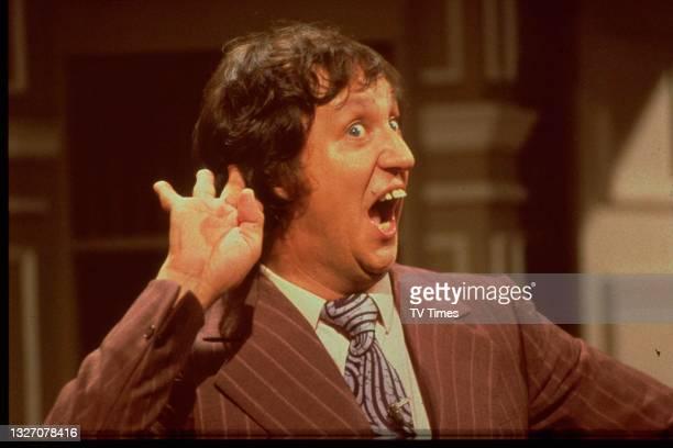 Entertainer Ken Dodd performing on stage, circa 1978.