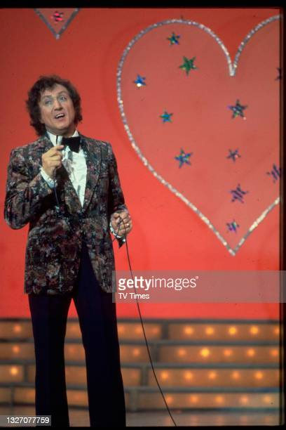 Entertainer Ken Dodd performing on the set of The Ken Dodd Laughter Show, circa 1979.