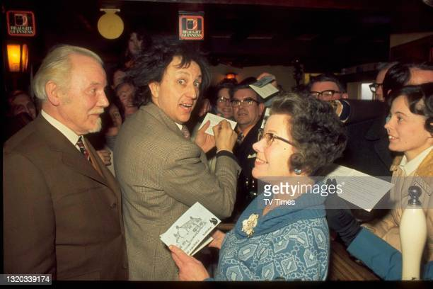 Entertainer Ken Dodd signing autographs for fans, circa 1972.