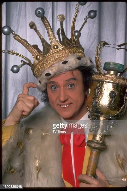 Entertainer Ken Dodd wearing a prop crown, circa 1972.
