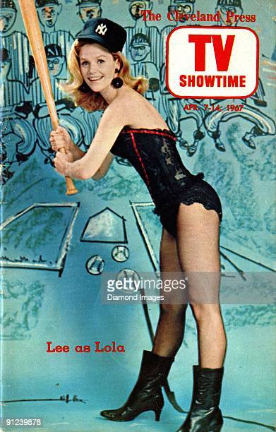 Entertainer Lee Remick poses for a promotional portrait in lingerie baseball cap and bat as the character Lola for a television adaptation of the...