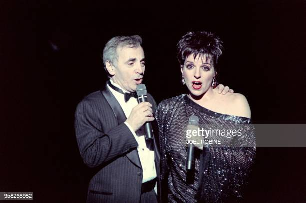 US entertainer Liza Minelli and French Charles Aznavour sing on November 20 1987 at the Lido cabaret in Paris to benefit cancer research AFP PHOTO...