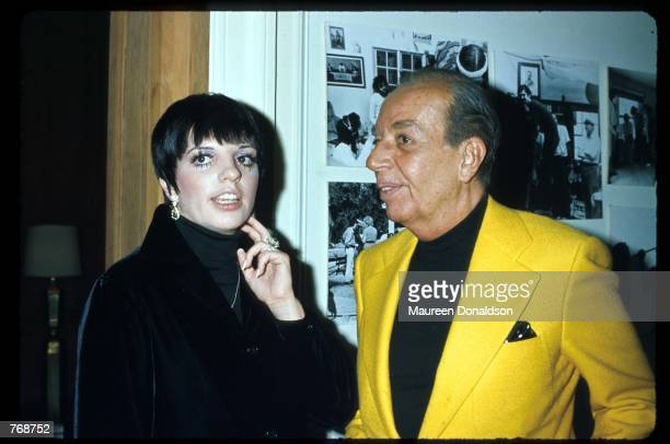 Entertainer Liza Minnelli stands with her father Vincente Minnelli December 1975 in Hollywood CA Minnelli has achieved the quadruple crown of...
