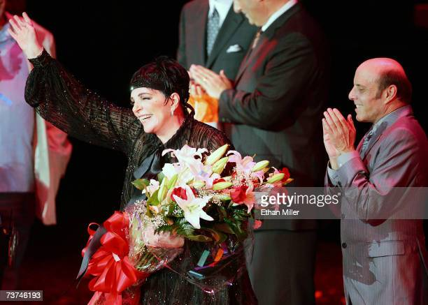 Entertainer Liza Minnelli waves to the crowd as her half-brother Joey Luft looks on after the first concert of Minnelli's three-night run at the...