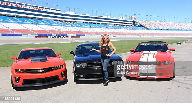 Entertainer Lorena Peril from the show 'Fantasy' poses in front of Chevrolet Camero ZL1 Dodge Challenger SRT8 392 and a Ford Mustang Shelby GT350 at...