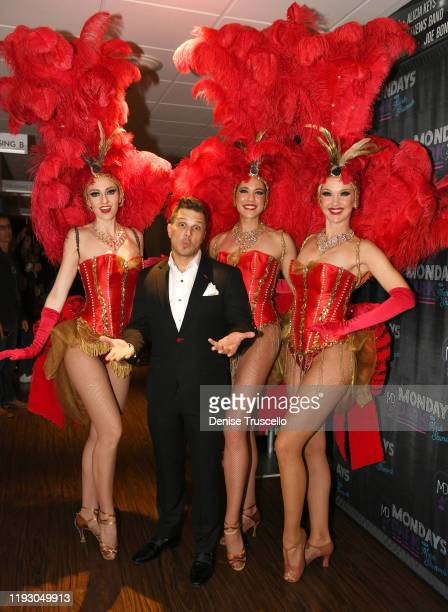 Entertainer Mark Shunock poses for a photo with Las Vegas Showgirls backstage at the 6th anniversary of Mondays Dark With Mark Shunock at the Pearl...