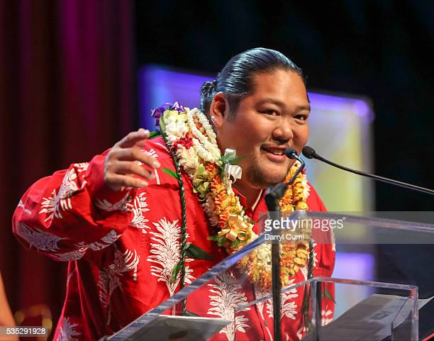 Entertainer Mark Yamanaka speaks to the audience after accepting the award for the Christmas Album of the Year at the 39th Na Hoku Hanohano Awards at...
