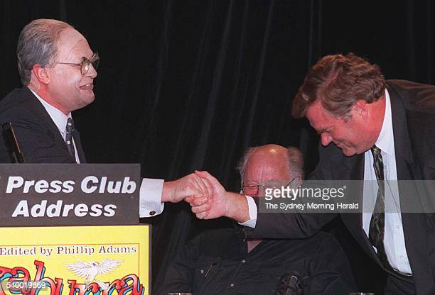 Entertainer Max Gillies left dressed as Prime Minister John Howard shakes hands with Opposition Leader Kim Beazley as Phillip Adams looks on during...