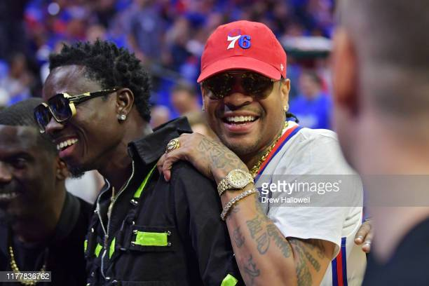 Entertainer Michael Blackson and former player Allen Iverson joke around before the game between the Philadelphia 76ers and Boston Celtics at Wells...