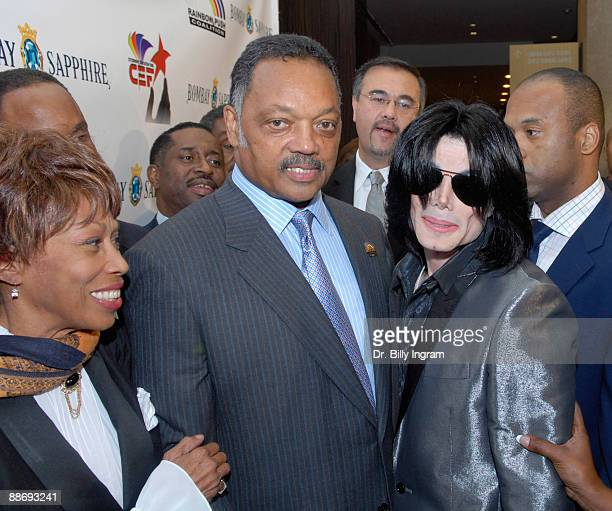 Entertainer Michael Jackson Jesse Jackson and Altovise Davis attend Jesse Jackson's 65th birthday at the Beverly Hilton Hotel on November 8 2007 in...