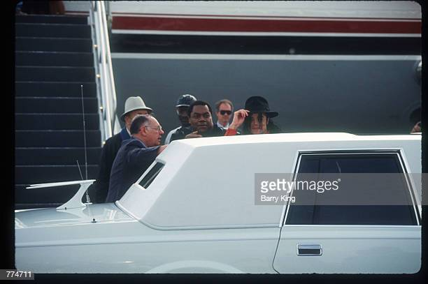 Entertainer Michael Jackson stands behind a limousine February 10 1992 in Los Angeles CA Jackson who was the lead singer for the Jackson Five by age...