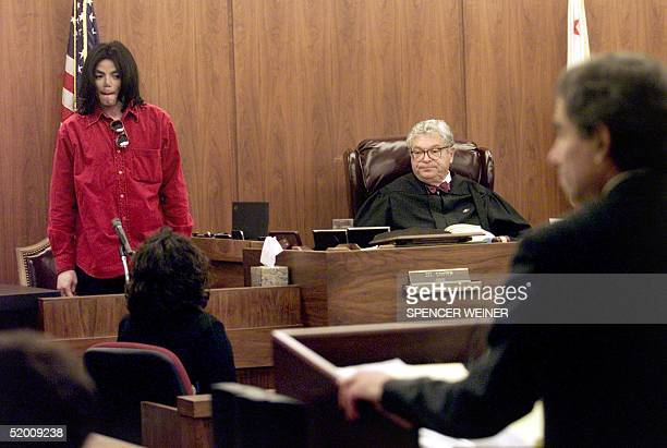 US entertainer Michael Jackson stands during court proceedings in Santa Maria Superior Court 13 November 2002 in a trial in which he is accused of...