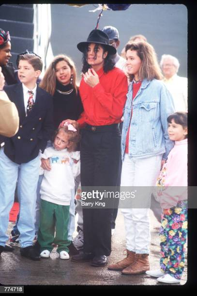 Entertainer Michael Jackson stands with fans February 10 1992 in Los Angeles CA Jackson who was the lead singer for the Jackson Five by age eight...
