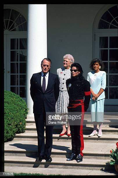 Entertainer Michael Jackson stands with President George Bush April 5 1990 at the White House Jackson who was the lead singer for the Jackson Five by...