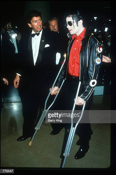 Entertainer Michael Jackson stands with the aid of crutches at a tribute held by the American Film Institute March 11, 1993 in Los Angeles, CA....