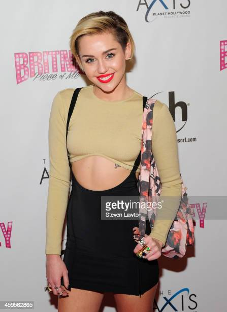 Entertainer Miley Cyrus arrives at the grand opening of Britney Spears' twoyear residency 'Britney Piece of Me' at Planet Hollywood Resort Casino on...