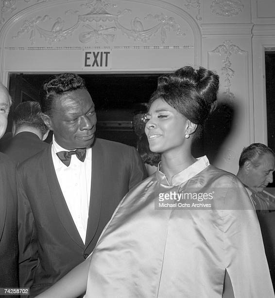 Entertainer Nat 'King' Cole chats with actress Leslie Uggams at the 35th Academy Awards ceremony which was held at the Santa Monica Civic Auditorium...