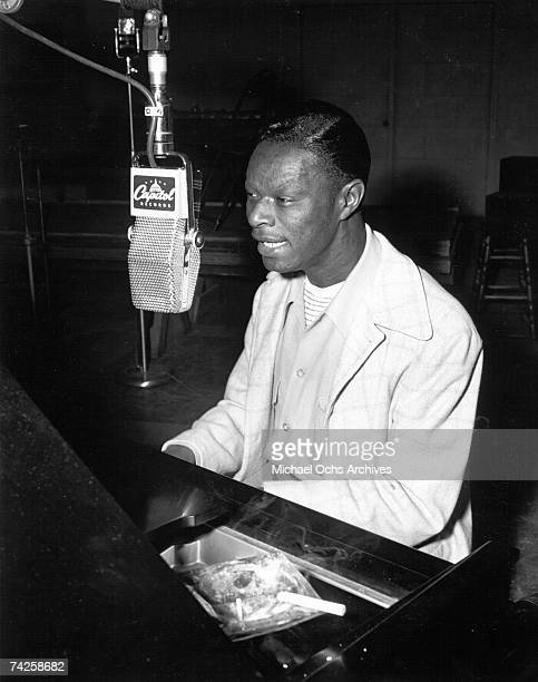 Entertainer Nat King Cole records at Capitol Recording Studios in circa 1946 in Los Angeles California