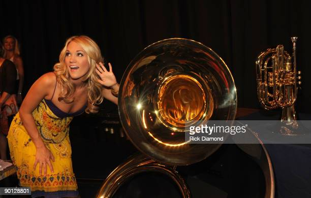 Entertainer of the Year Carrie Underwood speaks at Checotah High School to surprise students with more than $117000 in new music instruments a joint...