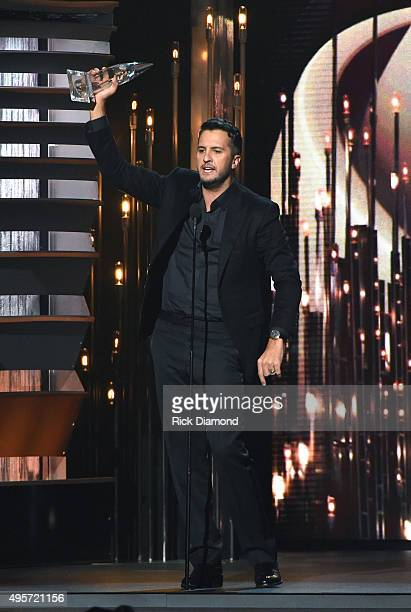 Entertainer of the Year winner Luke Bryan receives award onstage at the 49th annual CMA Awards at the Bridgestone Arena on November 4 2015 in...