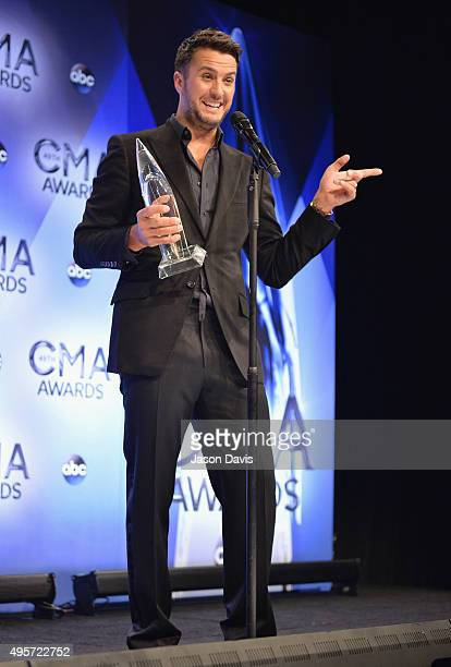 Entertainer of the Year winner Luke Bryan speaks in the press room during the 49th annual CMA Awards at the Bridgestone Arena on November 4 2015 in...