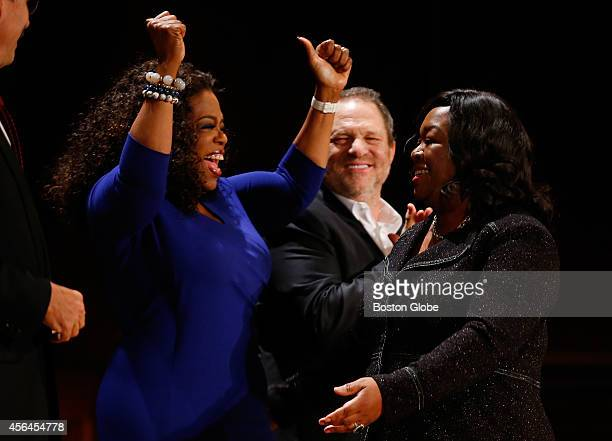 Entertainer Oprah Winfrey reacts as television producer and writer Shonda Rhimes right gets up to receive her WEB Du Bois Medal as CoChairman of The...