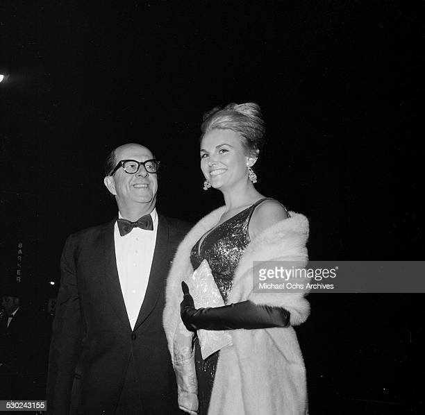 Entertainer Phil Silvers with actress Inga Neilson attend an event in Los AngelesCA