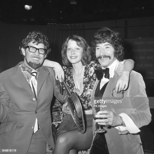 TV entertainer Rolf Harris left and actor Peter Wyngarde flank 20yearold Dutch model and actress Sylvia Kristel the new Miss TV Europe 1973 after her...