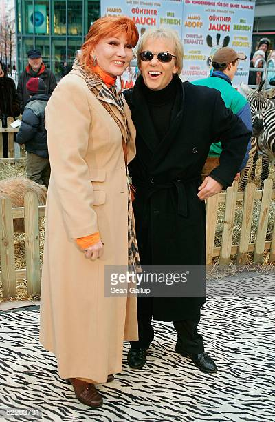 """Entertainer Romy Haag and friend Andy Moor arrive at the German premiere of """"Racing Stripes"""" on March 6, 2005 in Berlin, Germany."""