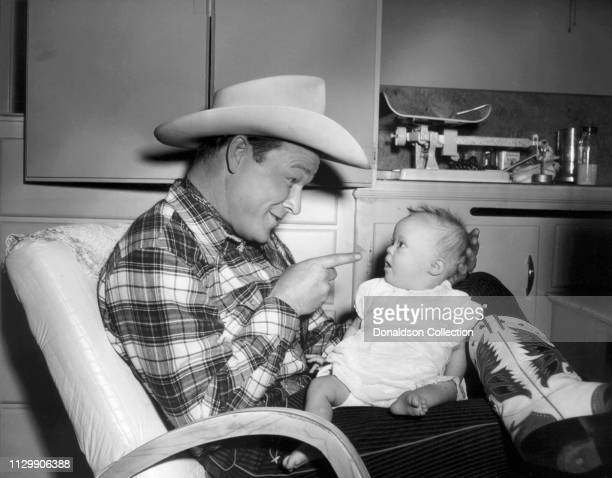 Entertainer Roy Rogers with his daughter Robin Elizabeth Rogers in 1957