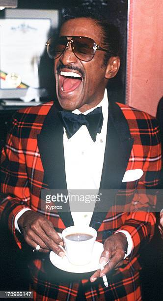 Entertainer Sammy Davis Jr drinking a cup of tea circa 1980