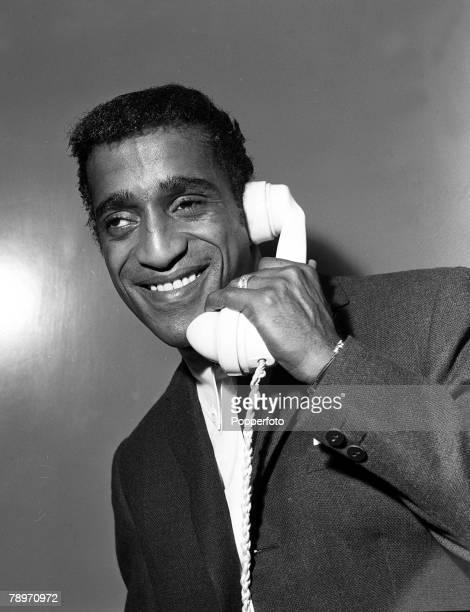 Entertainer Sammy Davis Jr speaking on the telephone in London 1961