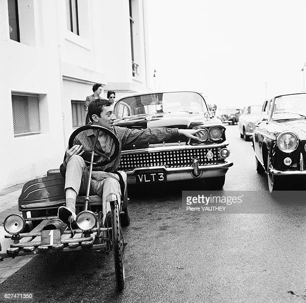 Entertainer Serge Gainsbourg prepares to pull out into traffic in Le TouquetParisPlage France