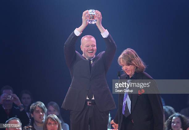 Entertainer Stefan Raab receives his Special Award from comedian Helge Schneider at the '1Live Krone' music awards at the Jahrhunderthalle on...