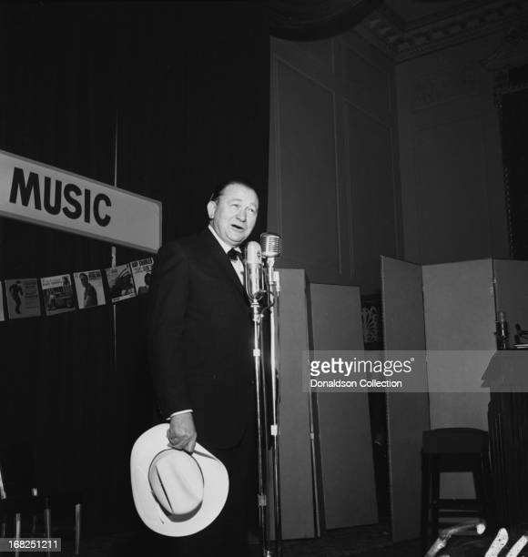 Entertainer Tex Ritter performs for the Country Music Association during a luncheon and recording session for the promotional album The Sounds Of...
