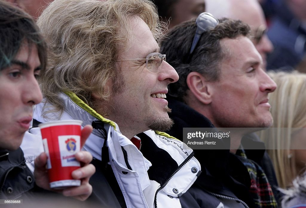 Entertainer Thomas Gottschalk (C) and formula 1 driver David Coulthard (R) attend at the Hahnenkamm Race on January 21, 2006 in Kitzbuehel, Austria